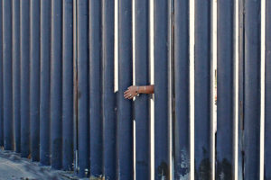 Pink Seesaws Prompt Laughter Across U.S.-Mexico Border-e-immigrate-news